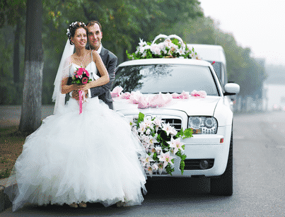 Bride & Groom in Front of Docorated Limo for Wedding
